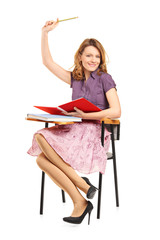 Beautiful female student with raised hand