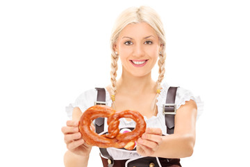 Blond woman holding a pretzel