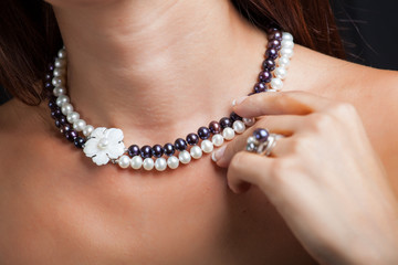 Woman with pearl necklace on her neck
