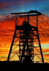 mine shaft with sunset