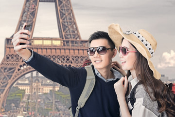 Asian couple travel and take a selfie