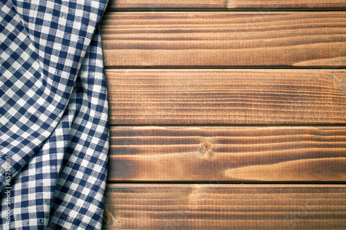 checkered napkin on wooden table