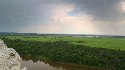 landscape with river and rain on horizon - panorama from height