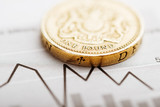 One pound coin on fluctuating graph