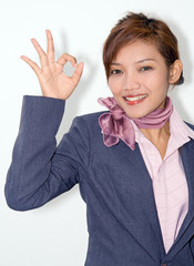 woman shows gesture on a white background ..