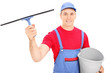 Male window cleaner holding a bucket
