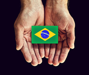 brazil flag in hands