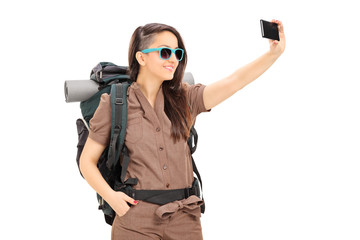 Female tourist taking selfie with cell phone
