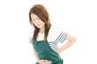 腹痛を訴える女性