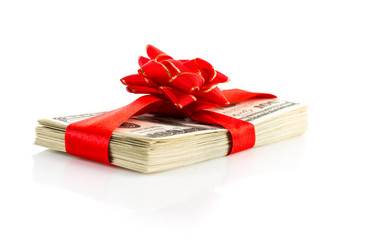 Money gift (big stack of dollars with red bow isolated