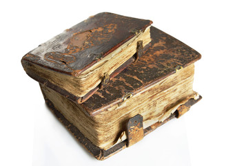 Ancient worn books with leather cover on light background