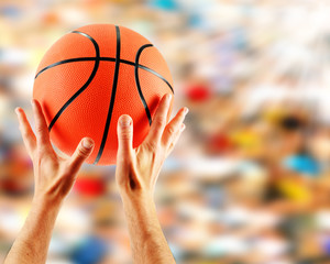 Hands catching basketball