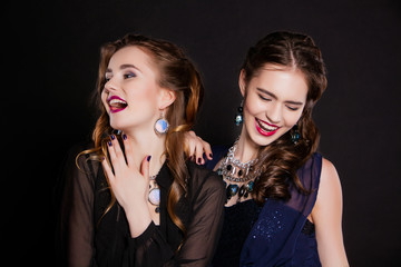 portrait of two beautiful young women with perfect makeup and
