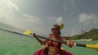 Young couple kayaking in tropical waters POV