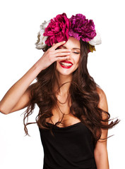 sexy smiling woman model with curle hair and bright flowers on