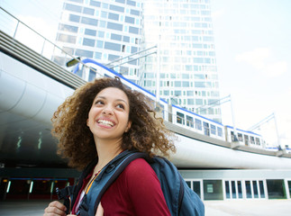 Woman smiling with backpack