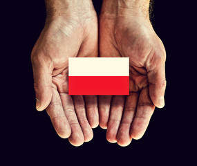 poland flag in hands