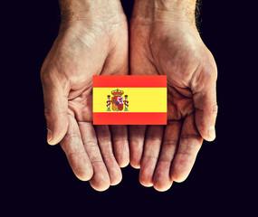 spain flag in hand.