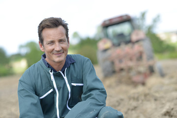Portrait of smiling farmer in cultivated land
