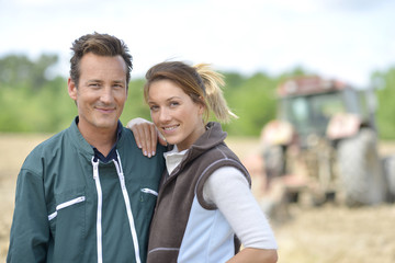 Couple of farmers standing in farming land
