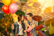 Happy couple in amusement park