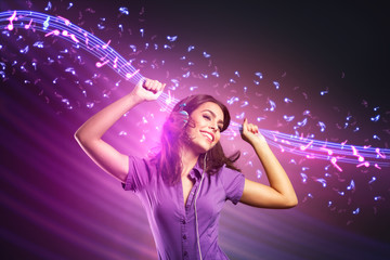 young girl dancing and listening music