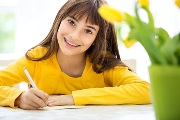 Cute little girl writing