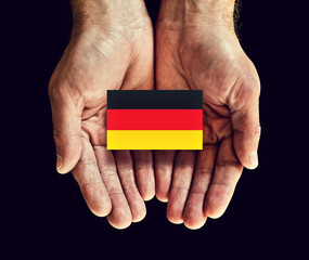 germany flag in hands