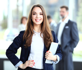 Business woman standing with a tablet in her hands