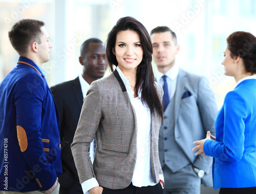 Business lady with positive look and cheerful smile