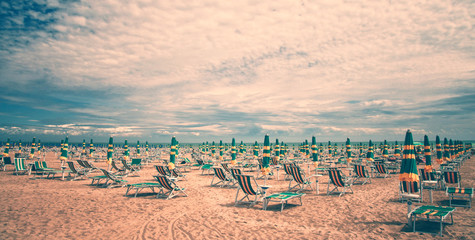 Vintage beach with deckchairs