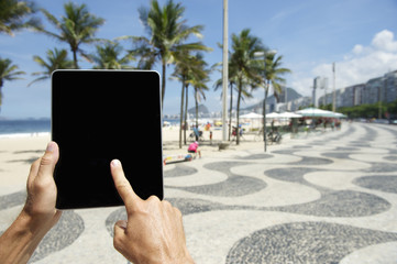 Traveling Tourist Using Tablet in Rio de Janeiro Brazil