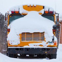 Parked school bus winter blizzard snow cover