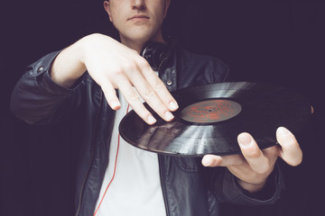 disc jockey hands with vinyl