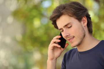 Handsome man talking on the mobile phone