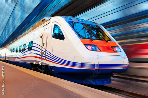 canvas print picture Modern high speed train with motion blur
