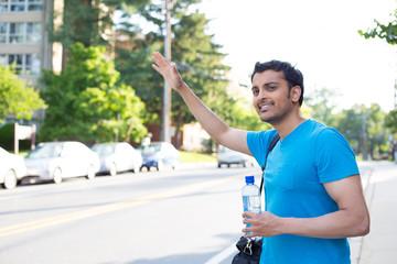 Hitchhiking or waving
