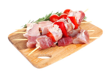 Raw pork kebab isolated on white