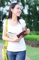 Asian woman student happy in university