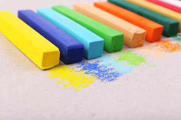 Colorful chalk pastels on color paper background