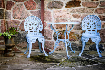 Patio furniture against stone wall