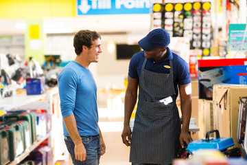 african hardware store salesman assisting customer