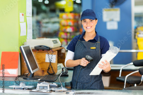 female cashier at hardware store - 65788313