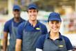 female supermarket worker and team