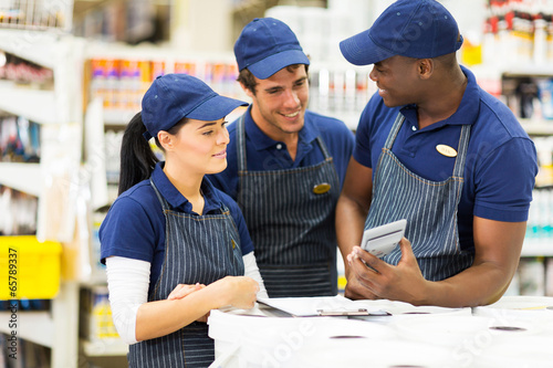 group of hardware store workers - 65789337