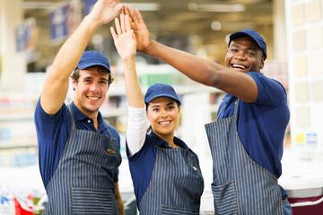 group of hardware store workers high five