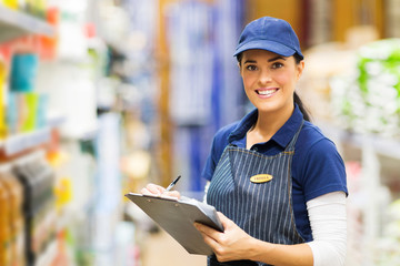 female clerk working in supermarket