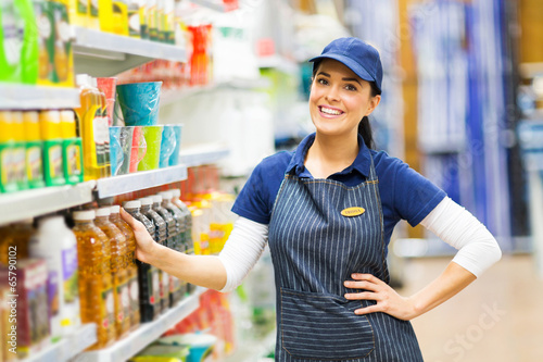 supermarket saleswoman standing in store - 65790102