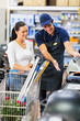 supermarket worker help female customer