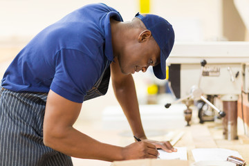 african carpenter working in workshop